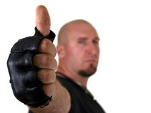 Strong man. Focus on the hand (thumbs up), isolated on white Royalty Free Stock Photos