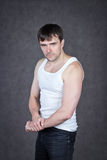 Strong man with a  background Royalty Free Stock Image