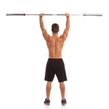 Strong Man With Barbell Back View Royalty Free Stock Images