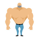Strong man bare-chested in blue jeans. Athletic body with huge m Stock Image