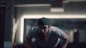 Strong man with beard wringing out, push-up. He looks in front of him. Strong man with a beard wringing out, push-up. He looks in front of him, technically stock footage