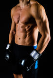 Strong man with black boxing gloves stock image