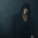Strong man in  black hoodie Royalty Free Stock Photo