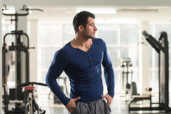 Strong Man in Blue T-shirt Background Gym Stock Photos
