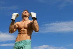 Strong man in boxing gloves. The winner. royalty free stock images
