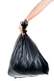 Strong man carry garbage in bag for eliminate. Strong man hand carry garbage in plastic bag for eliminate on the white background Royalty Free Stock Photo