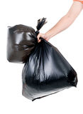 Strong man carry garbage in bag for eliminate. Strong man hand carry garbage in plastic bag for eliminate on the white background Stock Image