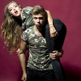 Strong man carry pretty woman Royalty Free Stock Images