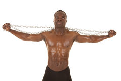 Strong man with chain arms out Royalty Free Stock Photography