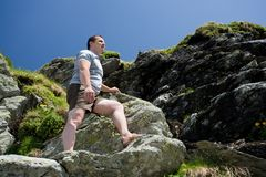 Strong man climbing mountain Royalty Free Stock Photography