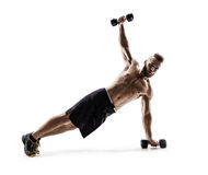 Strong man doing fitness plank position exercises with dumbbells. Photo of man in silhouette on white background. Fitness and healthy lifestyle concept Stock Photos