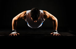 Strong man doing jumping push-ups Royalty Free Stock Photo