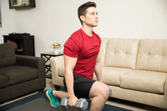 Strong man doing kneeling lunges at home Royalty Free Stock Images