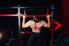 Strong man doing pull ups handsome athlete at gym. big confident muscular  training. Stock Images