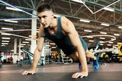 Strong Man Doing Push Ups in Gym royalty free stock photo