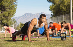 Strong Man Doing Push-Ups Royalty Free Stock Photography
