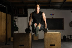 Strong man doing tricep dips Royalty Free Stock Photography