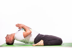 Strong man doing yoga Stock Images