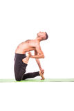 Strong man doing yoga Royalty Free Stock Photography
