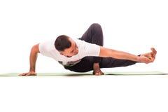 Strong man doing yoga Stock Photography