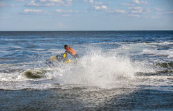 Strong man drive on the jetski above the water Royalty Free Stock Photos