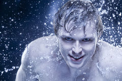 Strong man in drops of water Stock Photography