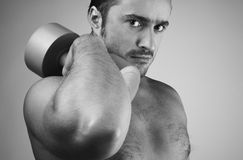 Strong man with dumbbells Royalty Free Stock Photos