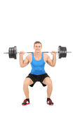 Strong man exercising with a barbell Royalty Free Stock Photos