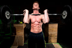 Strong man exercising in dramatic light Royalty Free Stock Photo