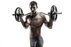 Strong man exercising fitness body building exercises with a barbell Royalty Free Stock Image