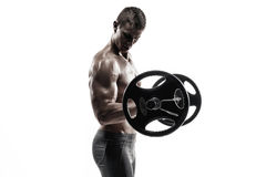 Strong man exercising fitness body building exercises with a barbell Stock Images