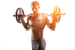 Strong man exercising fitness body building exercises with a barbell Stock Image