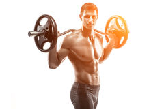 Strong man exercising fitness body building exercises with a barbell. Isolated on white background Whith solar flare Stock Photos