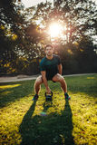 Strong man exercising with kettle bell in the park Royalty Free Stock Photo