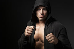 Strong man fighter portrait isolated on black Stock Image