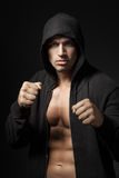 Strong man fighter portrait isolated on black. Background stock photo