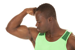 Strong man flex arm close. A very strong man is flexing his muscles Royalty Free Stock Image