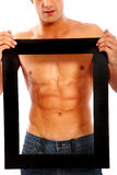 Strong man framing his abs Royalty Free Stock Photo
