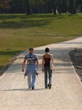 Strong Man And Girl Walking In The Park royalty free stock photo