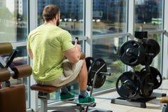 Strong man in gym. Stock Photos