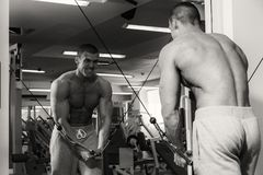 Strong man in gym. A healthy lifestyle, support for the figure Royalty Free Stock Photography