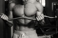 Strong man in gym. A healthy lifestyle, support for the figure Stock Photography