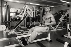 Strong man in gym. A healthy lifestyle, support for the figure Stock Photo