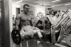 Strong man in gym. A healthy lifestyle, support for the figure Stock Photos