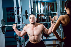 The strong man in the gym Royalty Free Stock Photo
