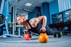 The strong man in the gym Stock Images
