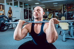 The strong man in the gym Royalty Free Stock Photography
