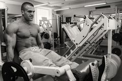 Strong man in gym. A healthy lifestyle, support for the figure Stock Images
