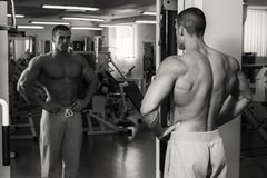 Strong man in gym. A healthy lifestyle, support for the figure Royalty Free Stock Image