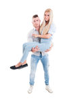 Strong man holding woman on his arms Stock Photo